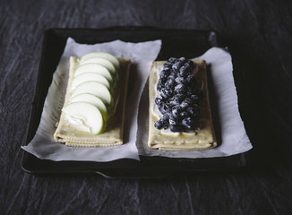 Cooking apple and berry pastries