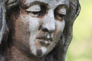 Statue of Virgin Mary in tears (sadness, fear, faith, religion)