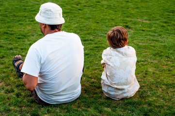 Father and son talk on the lawn