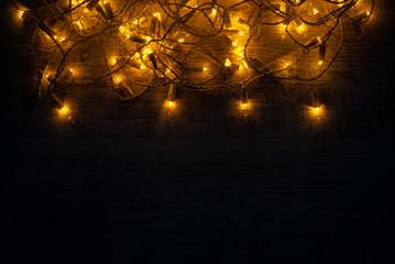 Christmas lights background concept on wooden desk.