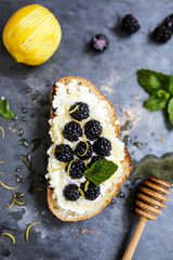 Blackberries, lemon and ricotta open sandwich