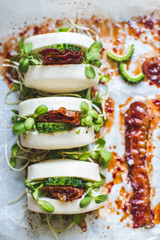 Steamed bread buns with bacon and pickled melon
