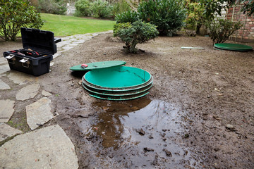 Septic system problems - Opening the lids to investigate leaks around a septic system's tanks & pump chamber