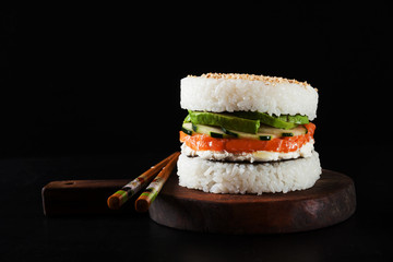 sushi menu with burger made from rice and smoked salmon, avocado