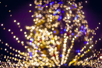 New Year tree in the city. The image is not in focus, beautiful bokeh