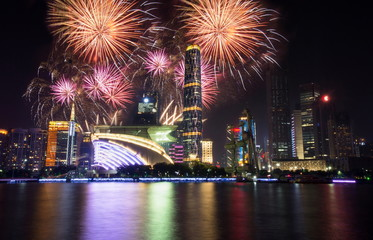 Fireworks over Guangzhou city modern buildings China