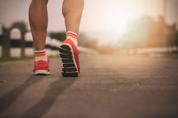 Closeup Runner feet running on road,Vintage Effect