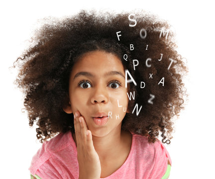 African-American little girl with book and alphabet letters on white background. Speech therapy concept