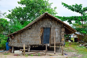 the hut in small fisherman village near the beach .small  grass house next to the sea