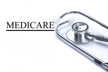 Page with Medicare on the table with stethoscope, medical concep
