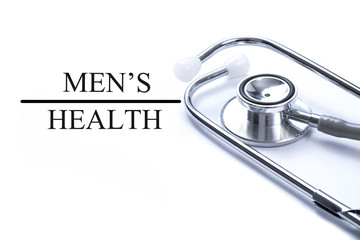 Page with Men's health on the table with stethoscope, medical co