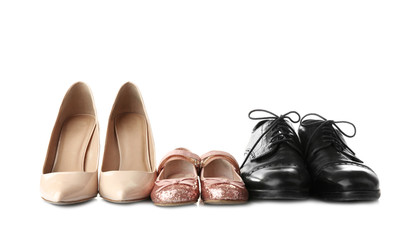 Family concept. Shoes for parents and child on white background