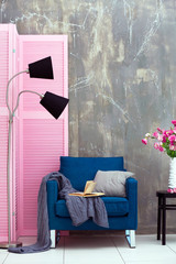 Modern room interior with pink wooden screen