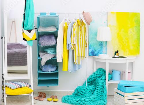 Fashionable clothes hanging on rack at modern dressing room stockfotos und lizenzfreie bilder - Foto moderne dressing ...