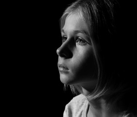 Black-and-white photo of sad little girl