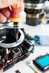 Repair broken DSLR camera in service