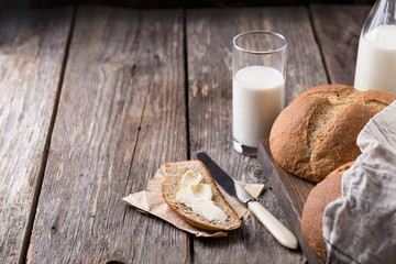 Rustic breakfast with wholegrain bread, milk and butter