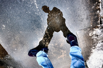 man silhouette shadow on concrete ground - reflected from water Wall mural