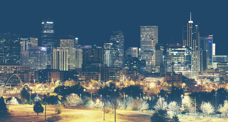 Retro toned Denver downtown skyline at night, USA.