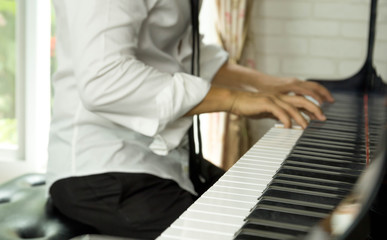 Selected focus on piano keys man playing the piano