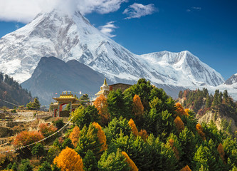 Buddhist monastery and Manaslu mount in Himalayas, Nepal.  View from Manaslu circuit trek