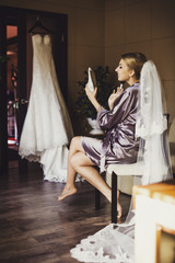 Portrait of beautiful bride. Morning of the bride. Posing on the