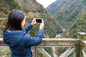 Young Woman taking photo with mobile phone