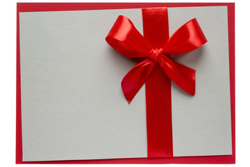 Red bow and ribbon on rough grey