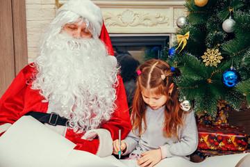 Little girl writes a letter to Santa.