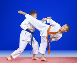 The blows karate are training two athletes