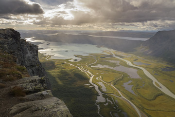 Cliff overlooking big river delta in lake autumn landscape with