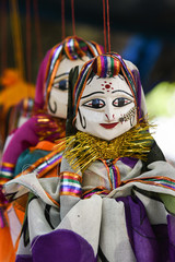 Fotobehang Carnaval Hand made puppets attached to string in Rajasthan India dolls. Women face with traditional Indian makeup wearing saree / sari / lehenga /choli
