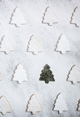 Christmas tree shaped cookies with icing sugar on white backgrou