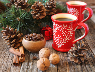 Two cup of coffee, coffee beans, pine cones and New-Year decorat