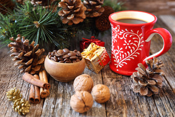 Cup of coffee, coffee beans and New-Year  decorations
