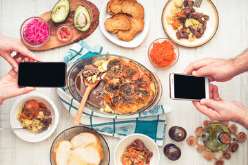 Dinner with mobile phone top view
