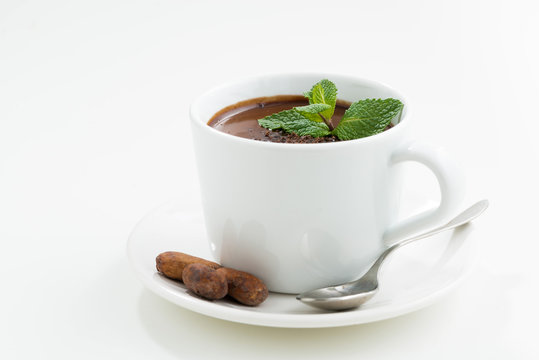 cup with hot mint chocolate on white table