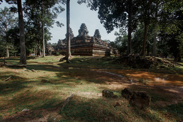 Mysterious Angkor Thom nestled among rainforest in Siem Reap, Ca
