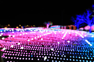 Colorful lights bokeh of night festival on street background