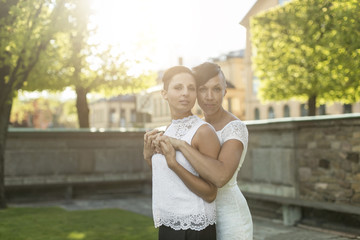 Portrait of newlywed lesbian couple at park