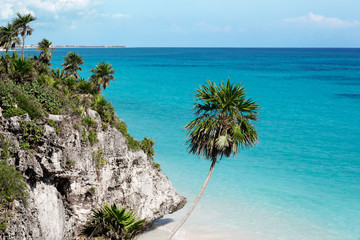 Beach below the cliffs of Tulum, Mexico