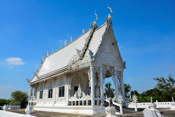 White temple of a buddha in Thailand.