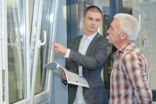 Salesman displaying double glazed windows for Double glazing salesman
