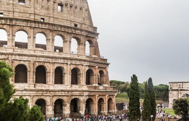 Tourists near Colosseum monument in Rome city. Italy