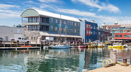 Water taxis and boats on the busy Maine Wharf, Portland, Maine