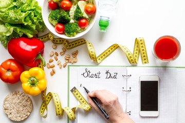 concept diet, slimming plan with vegetables top view mock up