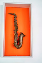 Saxophone on orange color background