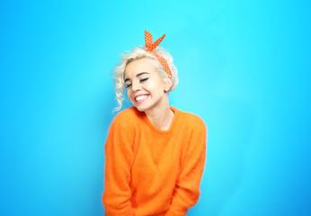 Portrait of funny emotional girl on blue background