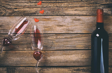 Red Wine and two Glasses in the shape of a Heart.Holiday Valentine's Day.Vintage style. Toned image.selective focus.
