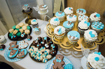 Delicious sweet buffet with cupcakes. Holiday table cakes and other desserts. Candy Bar.
